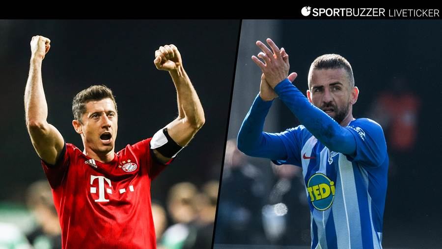 Münchens Robert Lewandowski (links) trifft auf Berlins Vedad Ibisevic.