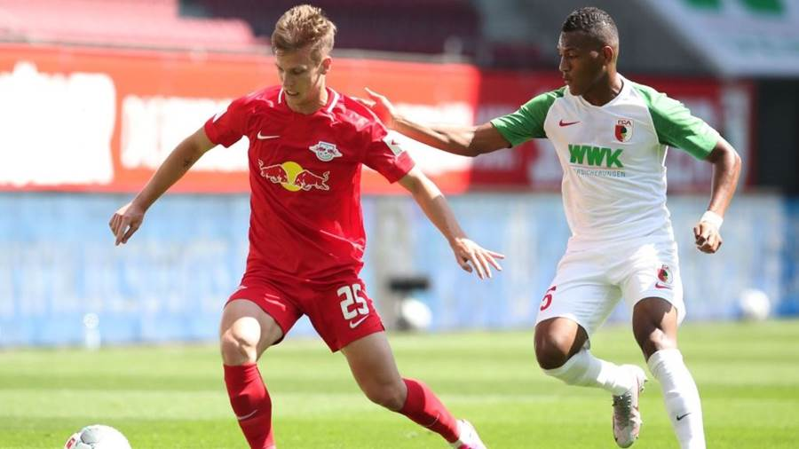 AUGSBURG, GERMANY - JUNE 27: Dani Olmo of Red Bull Leipzig is challenged by Carlos Gruezo of FC Augsburg during the Bundesliga match between FC Augsburg and RB Leipzig at WWK-Arena on June 27, 2020 in Augsburg, Germany. (Photo by Alexander Hassenstein/Getty Images)