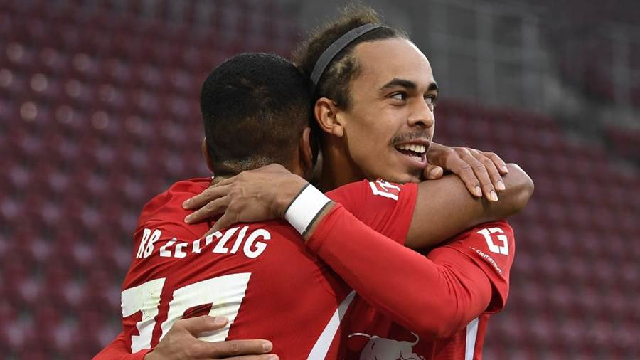 AUGSBURG, GERMANY - OCTOBER 17: Yussuf Poulsen of Leipzig celebrates his 0-2 goal during the German Bundesliga soccer match between FC Augsburg and RB Leipzig at WWK-Arena on October 17, 2020 in Augsburg, Germany. (Photo by Lukas Barth-Tuttas - Pool/Getty Images)