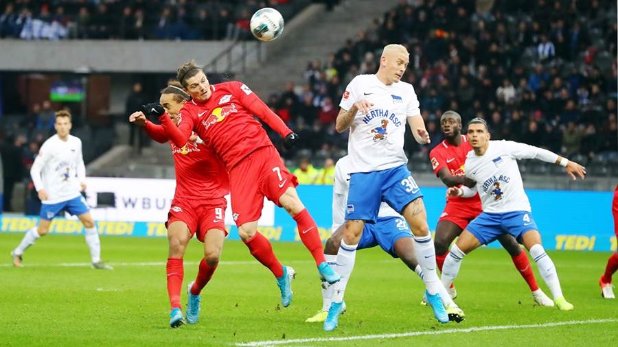 BERLIN,GERMANY,09.NOV.19 - SOCCER - 1. DFL, 1. Deutsche Bundesliga, Hertha BSC Berlin vs RasenBallsport Leipzig. Image shows Yussuf Poulsen (RB Leipzig), Marcel Sabitzer (RB Leipzig) and Marius Wolf (Berlin).  Photo: GEPA pictures/ Roger Petzsche - DFL regulations prohibit any use of photographs as image sequences and/or quasi-video - For editorial use only. Image is free of charge.