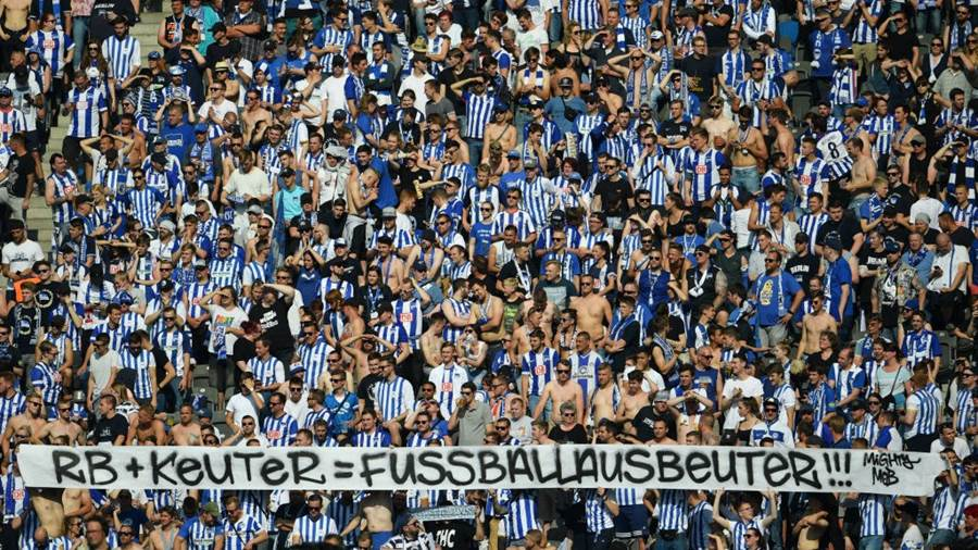 BERLIN, GERMANY - MAY 12: Supporters of Berlin show a protest banner against Hertha BSC marketing manager Paul Keuter during the Bundesliga match between Hertha BSC and RB Leipzig at Olympiastadion on May 12, 2018 in Berlin, Germany. (Photo by Thomas Starke/Bongarts/Getty Images)