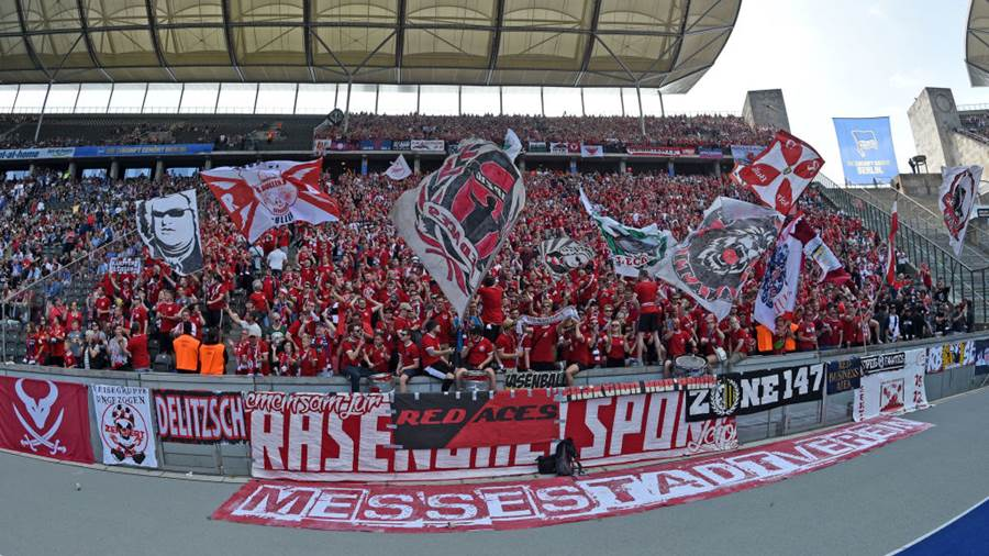 BERLIN, GERMANY - MAY 12: Supporters of Leipzig cheer their team prior to the Bundesliga match between Hertha BSC and RB Leipzig at Olympiastadion on May 12, 2018 in Berlin, Germany. (Photo by Thomas Starke/Bongarts/Getty Images)