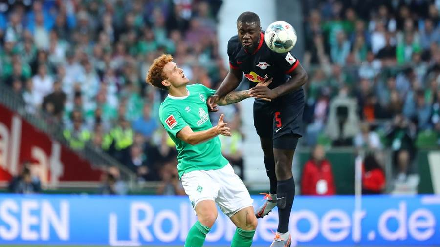 BREMEN,GERMANY,21.SEP.19 - SOCCER - 1. DFL, 1. Deutsche Bundesliga, SV Werder Bremen vs RasenBallsport Leipzig. Image shows Niklas Moisander (Bremen) and Dayot Upamecano (RB Leipzig). Photo: GEPA pictures/ Roger Petzsche - DFL regulations prohibit any use of photographs as image sequences and/or quasi-video - For editorial use only. Image is free of charge.