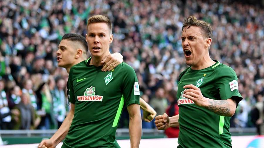 BREMEN, GERMANY - APRIL 15:  Max Kruse (R) of Bremen celebrates the opening goal during the Bundesliga match between SV Werder Bremen and RB Leipzig at Weserstadion on April 15, 2018 in Bremen, Germany.  (Photo by Stuart Franklin/Bongarts/Getty Images)