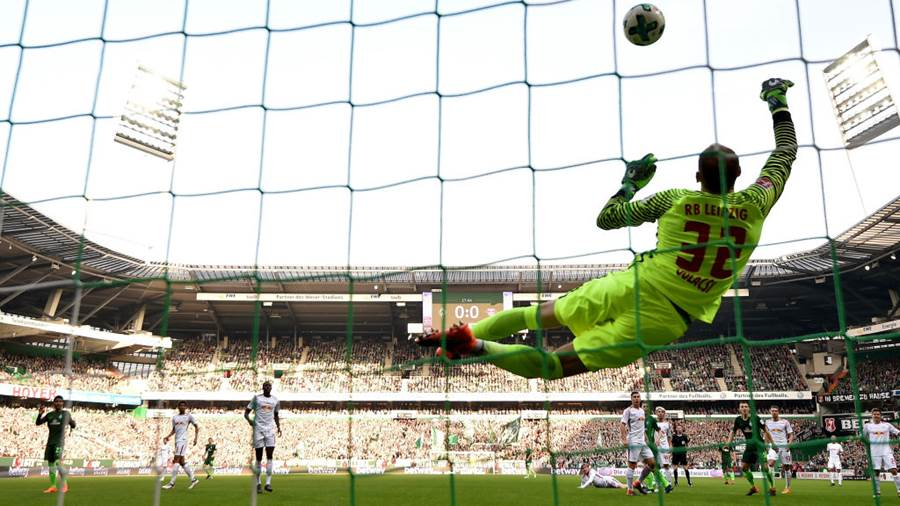 BREMEN, GERMANY - APRIL 15: Peter Gulacsi, goalkeeper of Leipzig makes a save during the Bundesliga match between SV Werder Bremen and RB Leipzig at Weserstadion on April 15, 2018 in Bremen, Germany.  (Photo by Stuart Franklin/Bongarts/Getty Images)