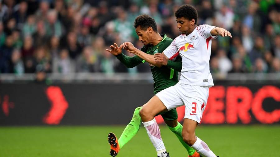 BREMEN, GERMANY - APRIL 15: Theodor Gebre Selassie (L) of Bremen and Bernardo of Leipzig battle for the ball during the Bundesliga match between SV Werder Bremen and RB Leipzig at Weserstadion on April 15, 2018 in Bremen, Germany.  (Photo by Stuart Franklin/Bongarts/Getty Images)