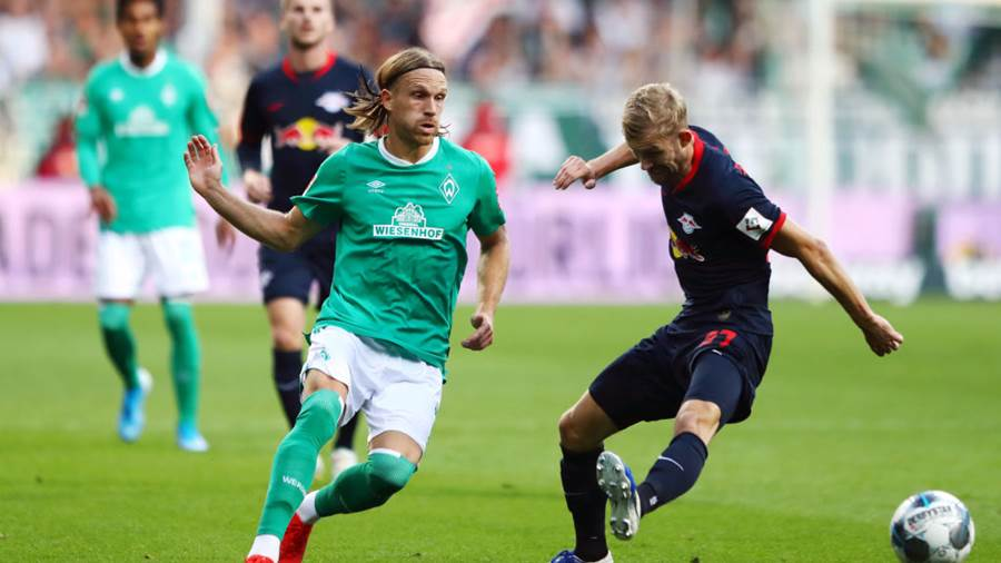 BREMEN, GERMANY - SEPTEMBER 21: Michael Lang of Werder Bremen  takes on Konrad Laimer of RB Leipzig during the Bundesliga match between SV Werder Bremen and RB Leipzig at Wohninvest Weserstadion on September 21, 2019 in Bremen, Germany. (Photo by Martin Rose/Bongarts/Getty Images)