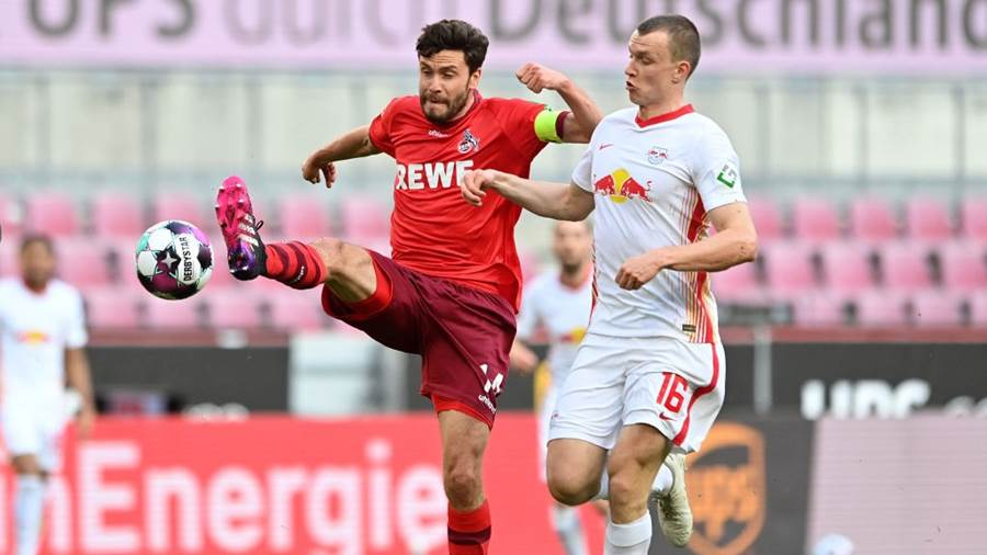 COLOGNE, GERMANY - APRIL 20: Jonas Hector of 1.FC Koeln and Lukas Klostermann of RB Leipzig  battle for the ball  during the Bundesliga match between 1. FC Koeln and RB Leipzig at RheinEnergieStadion on April 20, 2021 in Cologne, Germany. Sporting stadiums around Germany remain under strict restrictions due to the Coronavirus Pandemic as Government social distancing laws prohibit fans inside venues resulting in games being played behind closed doors. (Photo by Sascha Steinbach - Pool/Getty Images)