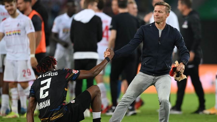 COLOGNE, GERMANY - SEPTEMBER 18: Team coach Jesse Marsch (R) and Mohamed Simakan of 1. FC Köln are pictured after their team's 1-1 draw after the Bundesliga match between 1. FC Köln and RB Leipzig at RheinEnergieStadion on September 18, 2021 in Cologne, Germany. (Photo by Matthias Hangst/Getty Images)