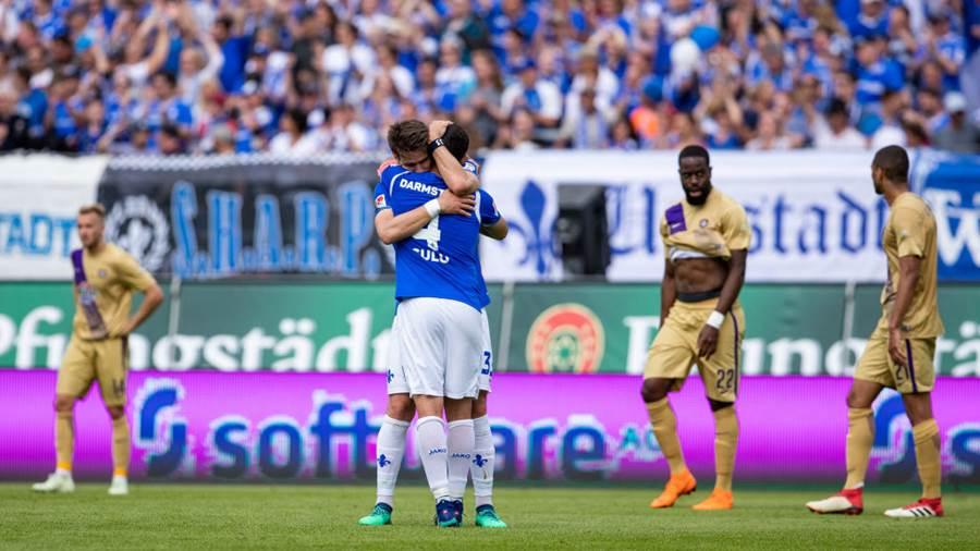 DARMSTADT, GERMANY - MAY 13: Aytac Sulu of Darmstadt celebrates winning with team mate Romain Bregerie as players of Aue react during the Second Bundesliga match between SV Darmstadt 98 and FC Erzgebirge Aue at Jonathan-Heimes-Stadion am Boellenfalltor on May 13, 2018 in Darmstadt, Germany. (Photo by Simon Hofmann/Bongarts/Getty Images)