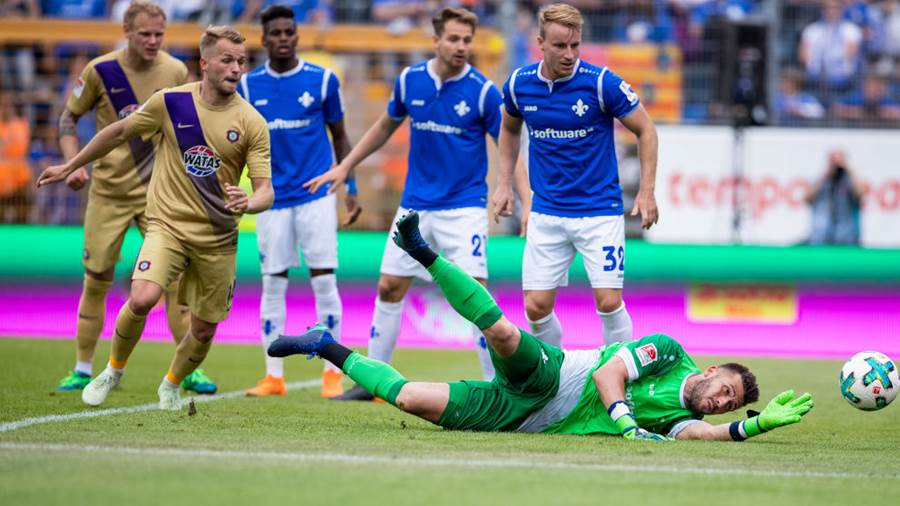 DARMSTADT, GERMANY - MAY 13: Goalkeeper Daniel Heuer Fernandes of Darmstadt makes a save during the Second Bundesliga match between SV Darmstadt 98 and FC Erzgebirge Aue at Jonathan-Heimes-Stadion am Boellenfalltor on May 13, 2018 in Darmstadt, Germany. (Photo by Simon Hofmann/Bongarts/Getty Images)