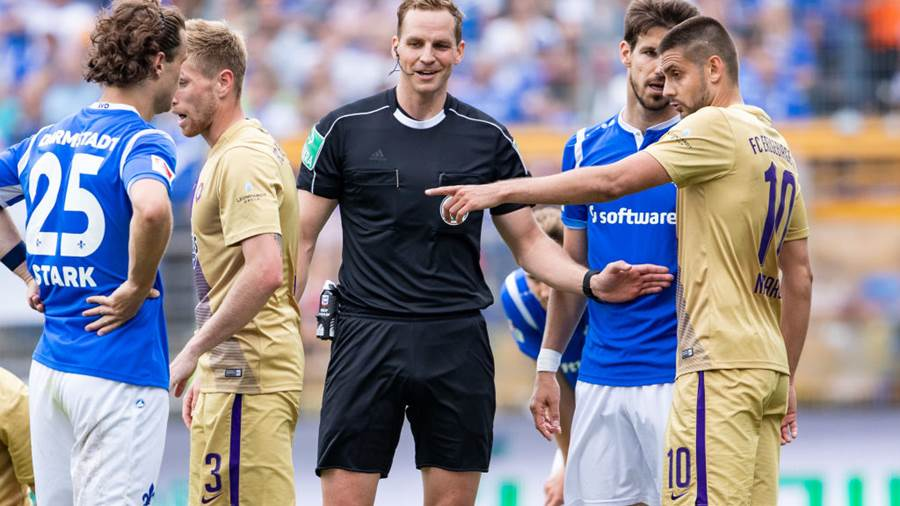 DARMSTADT, GERMANY - MAY 13: Referee Soeren Storks gestures during the Second Bundesliga match between SV Darmstadt 98 and FC Erzgebirge Aue at Jonathan-Heimes-Stadion am Boellenfalltor on May 13, 2018 in Darmstadt, Germany. (Photo by Simon Hofmann/Bongarts/Getty Images)