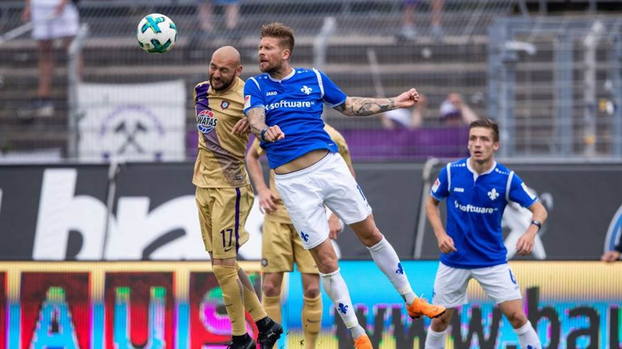 DARMSTADT, GERMANY - MAY 13: Tobias Kempe of Darmstadt jumps for a header with Philipp Riese of Aue during the Second Bundesliga match between SV Darmstadt 98 and FC Erzgebirge Aue at Jonathan-Heimes-Stadion am Boellenfalltor on May 13, 2018 in Darmstadt, Germany. (Photo by Simon Hofmann/Bongarts/Getty Images)
