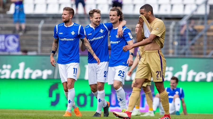 DARMSTADT, GERMANY - MAY 13: Tobias Kempe of Darmstadt (L) celebrates winning with team mates Immanuel Hoehn (C) and Yannick Stark (R) after the Second Bundesliga match between SV Darmstadt 98 and FC Erzgebirge Aue at Jonathan-Heimes-Stadion am Boellenfalltor on May 13, 2018 in Darmstadt, Germany. (Photo by Simon Hofmann/Bongarts/Getty Images)