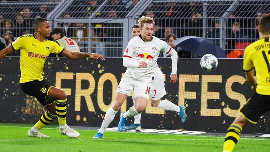 DORTMUND,GERMANY,17.DEC.19 - SOCCER - 1. DFL, 1. Deutsche Bundesliga, Borussia Dortmund vs RasenBallsport Leipzig. Image shows Emil Forsberg (RB Leipzig/ center). Photo: GEPA pictures/ Roger Petzsche - DFL regulations prohibit any use of photographs as image sequences and/or quasi-video - For editorial use only. Image is free of charge