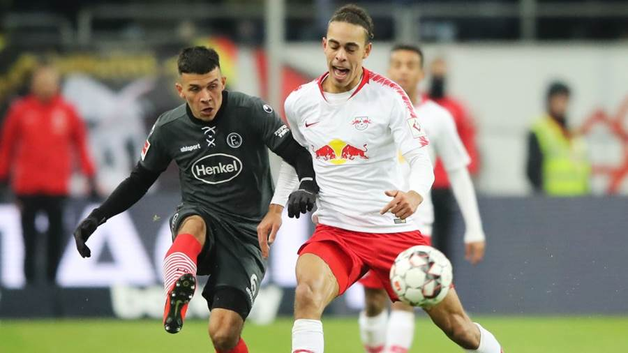 DUESSELDORF, GERMANY - JANUARY 27:  Alfredo Morales of Fortuna Duesseldorf clears from Yussuf Poulsen of RB Leipzig during the Bundesliga match between Fortuna Duesseldorf and RB Leipzig at Esprit-Arena on January 27, 2019 in Duesseldorf, Germany (Photo by Christof Koepsel/Bongarts/Getty Images)