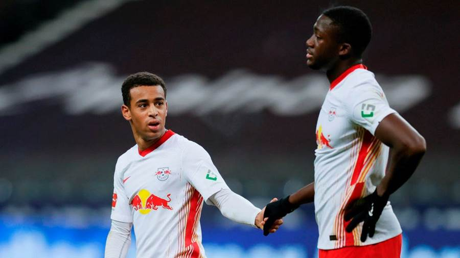 FRANKFURT AM MAIN, GERMANY - NOVEMBER 21: Tyler Adams (L)  and Ibrahima Konate of Leipzig react after the Bundesliga match between Eintracht Frankfurt and RB Leipzig at Deutsche Bank Park on November 21, 2020 in Frankfurt am Main, Germany. Football Stadiums around Europe remain empty due to the Coronavirus Pandemic as Government social distancing laws prohibit fans inside venues resulting in fixtures being played behind closed doors. (Photo by Ronald Wittek - Pool/Getty Images)