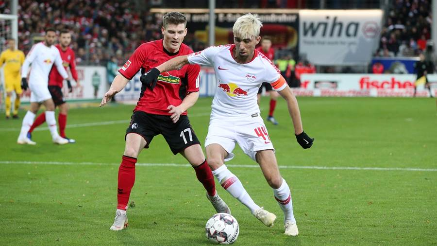 FREIBURG,GERMANY,08.DEC.18 - SOCCER - 1. DFL, 1. Deutsche Bundesliga, SC Freiburg vs RasenBallsport Leipzig. Image shows Lukas Kuebler (Freiburg) and Kevin Kampl (RB Leipzig). Photo: GEPA pictures/ Roger Petzsche - DFL regulations prohibit any use of photographs as image sequences and/or quasi-video - For editorial use only. Image is free of charge.