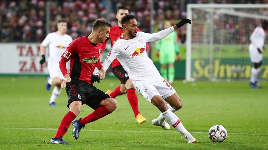 FREIBURG,GERMANY,08.DEC.18 - SOCCER - 1. DFL, 1. Deutsche Bundesliga, SC Freiburg vs RasenBallsport Leipzig. Image shows Janik Haberer (Freiburg) and Matheus Cunha (RB Leipzig). Photo: GEPA pictures/ Roger Petzsche - DFL regulations prohibit any use of photographs as image sequences and/or quasi-video - For editorial use only. Image is free of charge