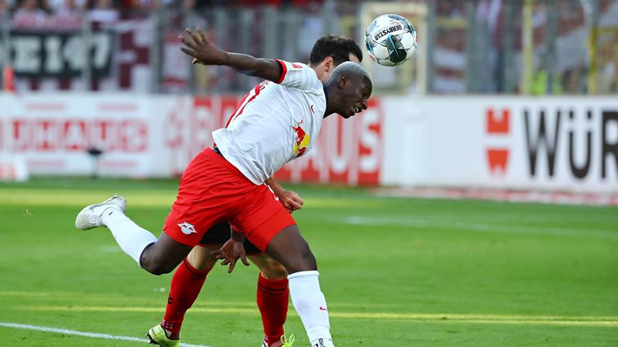 FREIBURG,GERMANY,26.OCT.19 - SOCCER - 1. DFL, 1. Deutsche Bundesliga, SC Freiburg vs RasenBallsport Leipzig. Image shows Amadou Haidara (RB Leipzig) and Nicolas Hoefler (Freiburg). Photo: GEPA pictures/ Roger Petzsche - DFL regulations prohibit any use of photographs as image sequences and/or quasi-video - For editorial use only. Image is free of charge.