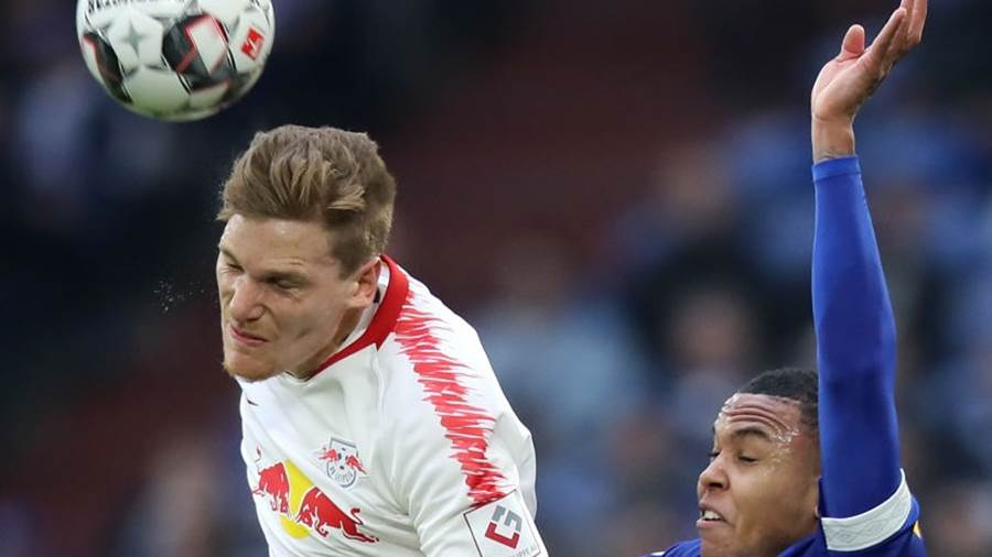 GELSENKIRCHEN, GERMANY - MARCH 16: Marcel Halstenberg of RB Leipzig battles for possession with Weston McKennie of FC Schalke 04 during the Bundesliga match between FC Schalke 04 and RB Leipzig at Veltins-Arena on March 16, 2019 in Gelsenkirchen, Germany. (Photo by Christof Koepsel/Bongarts/Getty Images)
