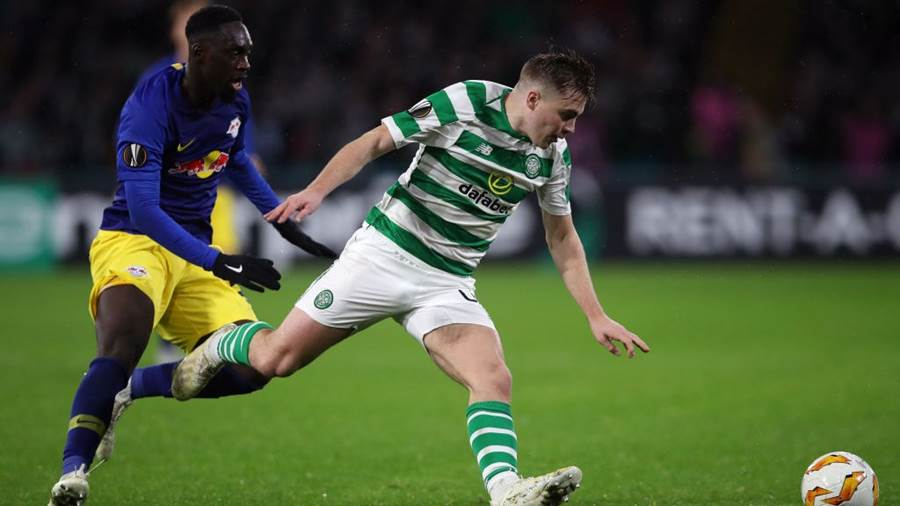 GLASGOW, SCOTLAND - NOVEMBER 08:  James Forrest of Celtic evades Jean-Kevin Augustin of RB Leipzig during the UEFA Europa League Group B match between Celtic and RB Leipzig at Celtic Park on November 8, 2018 in Glasgow, United Kingdom.  (Photo by Ian MacNicol/Getty Images)