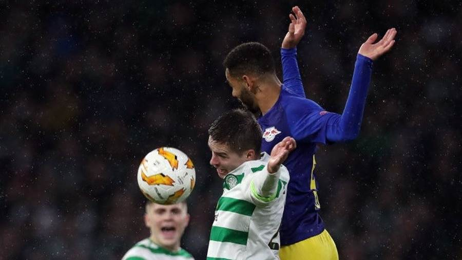 GLASGOW, SCOTLAND - NOVEMBER 08:  Mikael Lustig of Celtic and Matheus Cunha of RB Leipzig jump for the ball during the UEFA Europa League Group B match between Celtic and RB Leipzig at Celtic Park on November 8, 2018 in Glasgow, United Kingdom.  (Photo by Ian MacNicol/Getty Images)