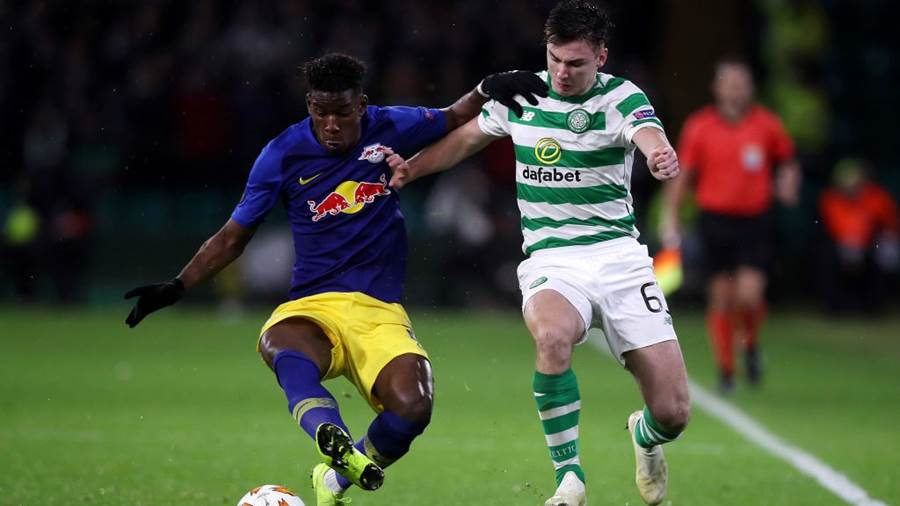 GLASGOW, SCOTLAND - NOVEMBER 08:  Nordi Mukiele of RB Leipzig holds off Kieran Tierney of Celtic during the UEFA Europa League Group B match between Celtic and RB Leipzig at Celtic Park on November 8, 2018 in Glasgow, United Kingdom.  (Photo by Ian MacNicol/Getty Images)