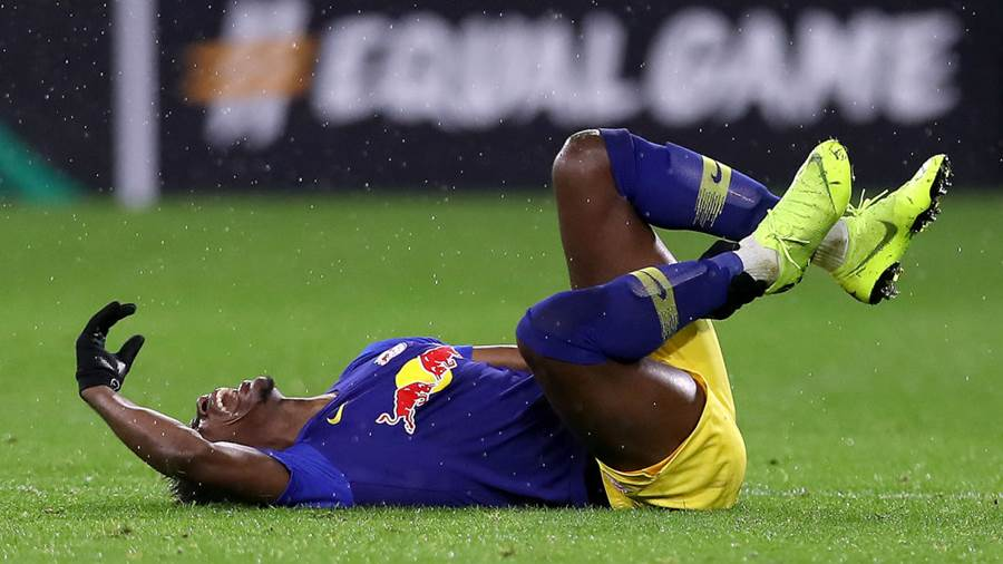 GLASGOW, SCOTLAND - NOVEMBER 08:  Nordi Mukiele of RB Leipzig is injured during the UEFA Europa League Group B match between Celtic and RB Leipzig at Celtic Park on November 8, 2018 in Glasgow, United Kingdom.  (Photo by Ian MacNicol/Getty Images)