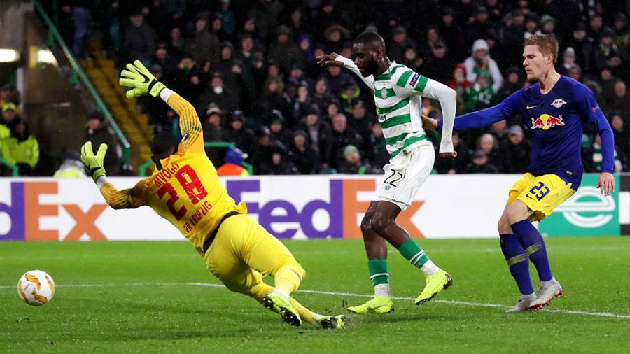 GLASGOW, SCOTLAND - NOVEMBER 08:  Odsonne Edouard of Celtic (C) scores his team's second goal past Yvon Mvogo of RB Leipzig  during the UEFA Europa League Group B match between Celtic and RB Leipzig at Celtic Park on November 8, 2018 in Glasgow, United Kingdom.  (Photo by Ian MacNicol/Getty Images)