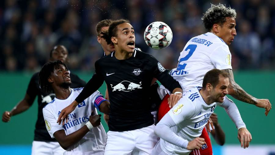 HAMBURG, GERMANY - APRIL 23: Yussuf Poulsen of Leipzig is challenged by Gideon Jung of Hamburg, Leo Lacroix of Hamburg and Pierre Michel Lasogga of Hamburg during the DFB Cup semi final match between Hamburger SV and RB Leipzig at Imtech Arena on April 23, 2019 in Hamburg, Germany. (Photo by Martin Rose/Bongarts/Getty Images)