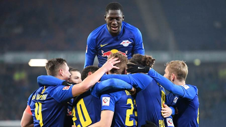 HANOVER, GERMANY - FEBRUARY 01: Marcel Halstenberg of RB Leipzig (hidden) celebrates with teammates after scoring his team's first goal from the penalty spot during the Bundesliga match between Hannover 96 and RB Leipzig at HDI-Arena on February 01, 2019 in Hanover, Germany (Photo by Stuart Franklin/Bongarts/Getty Images)