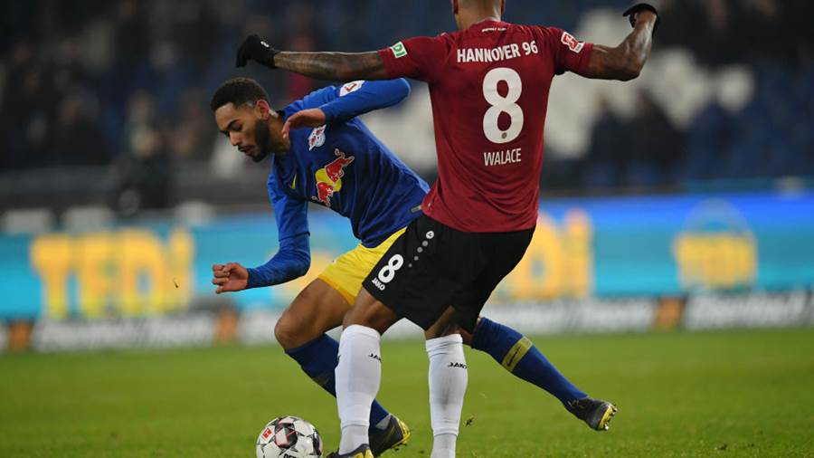 HANOVER, GERMANY - FEBRUARY 01: Matheus Cunha of RB Leipzig is tackled by Walace of Hannover 96 during the Bundesliga match between Hannover 96 and RB Leipzig at HDI-Arena on February 01, 2019 in Hanover, Germany. (Photo by Stuart Franklin/Bongarts/Getty Images)