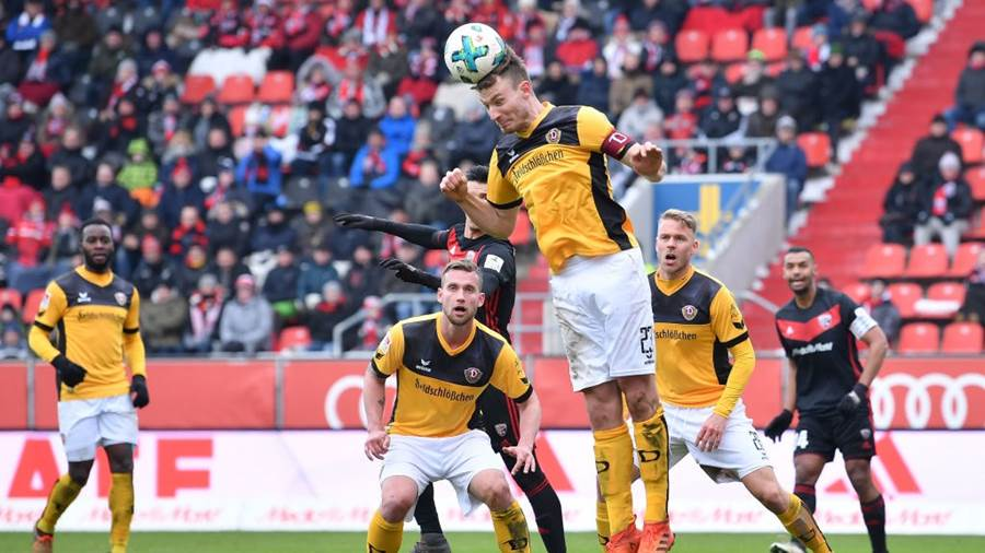INGOLSTADT, GERMANY - MARCH 18: Florian Ballas of Dresden jumps for a header during the Second Bundesliga match between FC Ingolstadt 04 and SG Dynamo Dresden at Audi Sportpark on March 18, 2018 in Ingolstadt, Germany. (Photo by Sebastian Widmann/Bongarts/Getty Images)