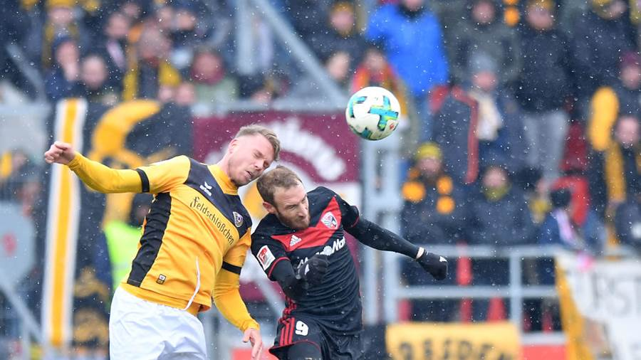INGOLSTADT, GERMANY - MARCH 18: Marcel Franke of Dresden and Moritz Hartmann of Ingolstadt jump for a header during the Second Bundesliga match between FC Ingolstadt 04 and SG Dynamo Dresden at Audi Sportpark on March 18, 2018 in Ingolstadt, Germany. (Photo by Sebastian Widmann/Bongarts/Getty Images)