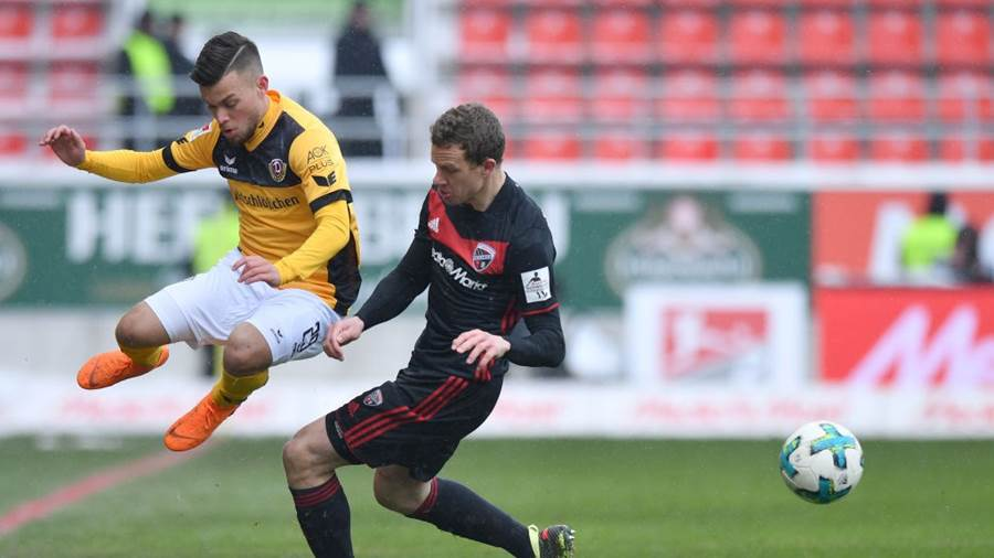 INGOLSTADT, GERMANY - MARCH 18: Sascha Horvath of Dresden and Marcel Gaus of Ingolstadt compete for the ball during the Second Bundesliga match between FC Ingolstadt 04 and SG Dynamo Dresden at Audi Sportpark on March 18, 2018 in Ingolstadt, Germany. (Photo by Sebastian Widmann/Bongarts/Getty Images)