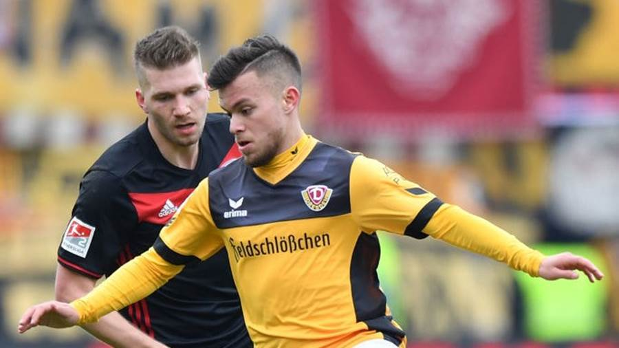 INGOLSTADT, GERMANY - MARCH 18: Sascha Horvath of Dresden and Robert Leipertz of Ingolstadt compete for the ball during the Second Bundesliga match between FC Ingolstadt 04 and SG Dynamo Dresden at Audi Sportpark on March 18, 2018 in Ingolstadt, Germany. (Photo by Sebastian Widmann/Bongarts/Getty Images)