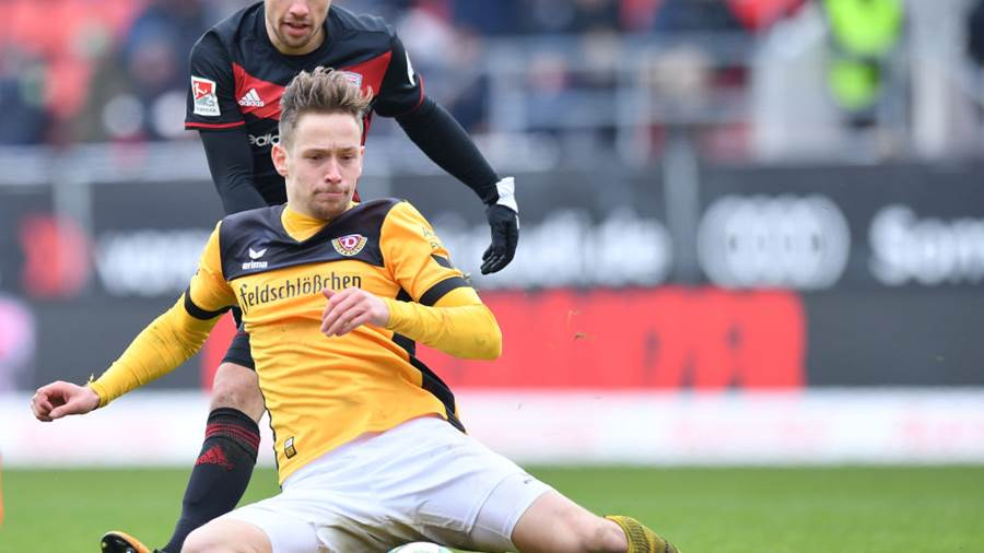INGOLSTADT, GERMANY - MARCH 18: Thomas Pledl of Ingolstadt and Jannik Mueller of Dresden compete for the ball during the Second Bundesliga match between FC Ingolstadt 04 and SG Dynamo Dresden at Audi Sportpark on March 18, 2018 in Ingolstadt, Germany. (Photo by Sebastian Widmann/Bongarts/Getty Images)