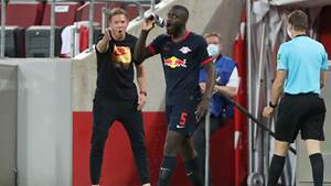 KOELN,GERMANY,01.JUN.20 - SOCCER - 1. DFL, 1. Deutsche Bundesliga, 1. FC Koeln vs RasenBallsport Leipzig. Image shows head coach Julian Nagelsmann and Dayot Upamecano (RB Leipzig). Photo: GEPA pictures/ Sebastian El Saqqa/ firosportphoto/ POOL via Picture Point - ATTENTION - COPYRIGHT FOR AUSTRIAN CLIENTS ONLY - DFL regulations prohibit any use of photographs as image sequences and/or quasi-video - Editorial Use ONLY - For editorial use only. Image is free of charge.
