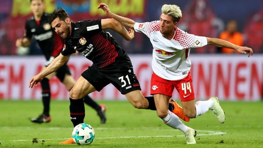 (L) of Leipzig and of Leverkusen battle for the ball during the Bundesliga match between RB Leipzig and Bayer 04 Leverkusen at Red Bull Arena on April 9, 2018 in Leipzig, Germany.