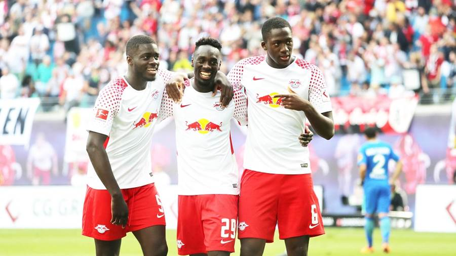 LEIPZIG,GERMANY,05.MAY.18 - SOCCER - 1. DFL, 1. Deutsche Bundesliga, RasenBallsport Leipzig vs VfL Wolfsburg. Image shows the rejoicing of Dayot Upamecano, Jean-Kevin Augustin and Ibrahima Konate (RB Leipzig). Photo: GEPA pictures/ Sven Sonntag - For editorial use only. Image is free of charge.