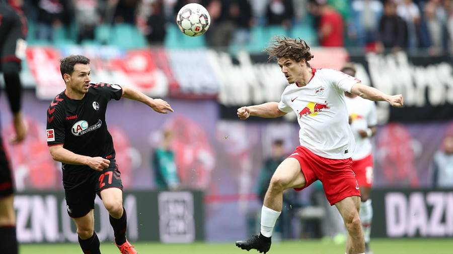 LEIPZIG,GERMANY,27.APR.19 - SOCCER - 1. DFL, 1. Deutsche Bundesliga, RasenBallsport Leipzig vs SC Freiburg. Image shows Nicolas Hoefler (Freiburg) and Marcel Sabitzer (RB Leipzig). Photo: GEPA pictures/ Roger Petzsche - DFL regulations prohibit any use of photographs as image sequences and/or quasi-video - For editorial use only. Image is free of charge
