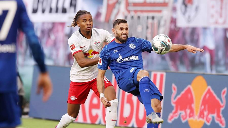 LEIPZIG,GERMANY,28.SEP.19 - SOCCER - 1. DFL, 1. Deutsche Bundesliga, RasenBallsport Leipzig vs FC Schalke 04. Image shows Christopher Nkunku (RB Leipzig) and Daniel Caligiuri (Schalke). Photo: GEPA pictures/ Sven Sonntag - DFL regulations prohibit any use of photographs as image sequences and/or quasi-video - For editorial use only. Image is free of charge