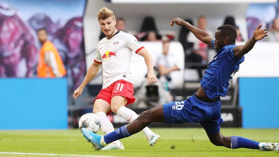 LEIPZIG,GERMANY,28.SEP.19 - SOCCER - 1. DFL, 1. Deutsche Bundesliga, RasenBallsport Leipzig vs FC Schalke 04. Image shows Timo Werner (RB Leipzig) and  Salif Sane (Schalke). Photo: GEPA pictures/ Sven Sonntag - DFL regulations prohibit any use of photographs as image sequences and/or quasi-video - For editorial use only. Image is free of charge.