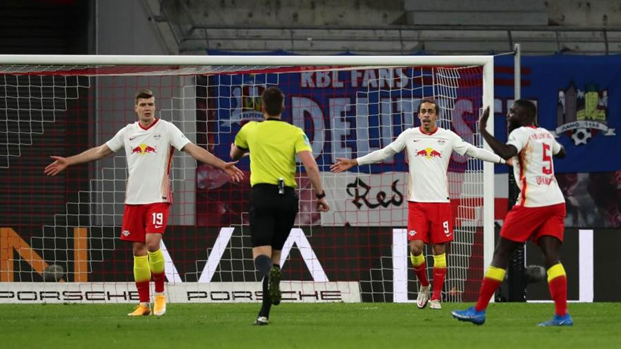LEIPZIG, GERMANY - APRIL 03: Alexander Sorloth and Yussuf Poulsen of RB Leipzig react during the Bundesliga match between RB Leipzig and FC Bayern Muenchen at Red Bull Arena on April 03, 2021 in Leipzig, Germany. Sporting stadiums around Germany remain under strict restrictions due to the Coronavirus Pandemic as Government social distancing laws prohibit fans inside venues resulting in games being played behind closed doors. (Photo by Filip Singer - Pool/Getty Images)