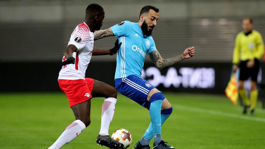 LEIPZIG, GERMANY - APRIL 05: Ibrahima Konate (L) of RB Leipzig vies with Kostas Mitroglou (R) of Olympique Marseille during the UEFA Europa League quarter final leg one match between RB Leipzig and Olympique Marseille at the Red Bull Arena on April 5, 2018 in Leipzig, Germany. (Photo by Ronny Hartmann/Bongarts/Getty Images)