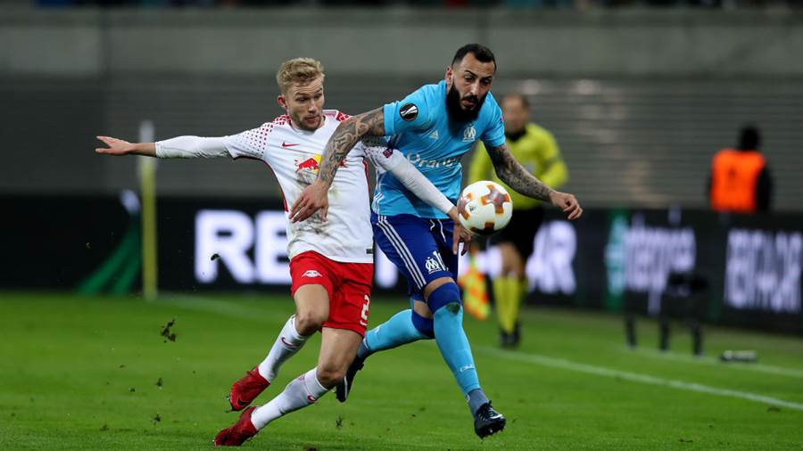 LEIPZIG, GERMANY - APRIL 05: Konrad Laimer (L) of RB Leipzig vies with Kostas Mitroglou (R) of Olympique Marseille during the UEFA Europa League quarter final leg one match between RB Leipzig and Olympique Marseille at the Red Bull Arena on April 5, 2018 in Leipzig, Germany. (Photo by Ronny Hartmann/Bongarts/Getty Images)