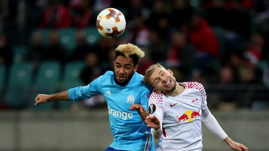 LEIPZIG, GERMANY - APRIL 05: Konrad Laimer (R) of RB Leipzig vies with Jordan Amavi (L) of Olympique Marseille during the UEFA Europa League quarter final leg one match between RB Leipzig and Olympique Marseille at the Red Bull Arena on April 5, 2018 in Leipzig, Germany. (Photo by Ronny Hartmann/Bongarts/Getty Images)