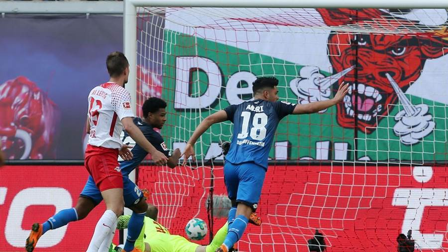 LEIPZIG, GERMANY - APRIL 21:  Serge Gnabry (C) of Hoffenheim scores the second goal during the Bundesliga match between RB Leipzig and TSG 1899 Hoffenheim at Red Bull Arena on April 21, 2018 in Leipzig, Germany.  (Photo by Matthias Kern/Bongarts/Getty Images)
