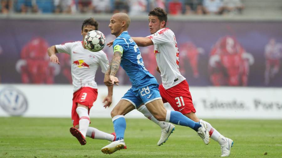 LEIPZIG, GERMANY - AUGUST 09:  Diego Demme of Leipzig challenges Ionut Mitrita of Craiova during the UEFA Europa League Third Qualifying Round: 1st leg between RB Leipzig and Universitatea Craiova at Red Bull Arena on August 09, 2018 in Leipzig, Germany. (Photo by Karina Hessland-Wissel/Bongarts/Getty Images)